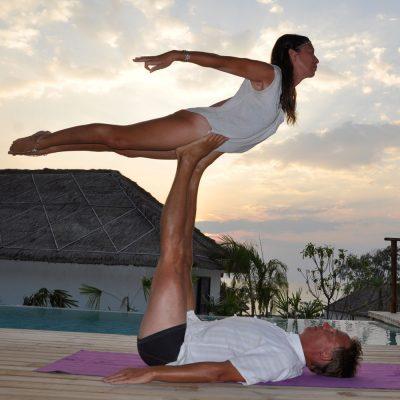 Partner acrobatics Front Bird pose at sunset